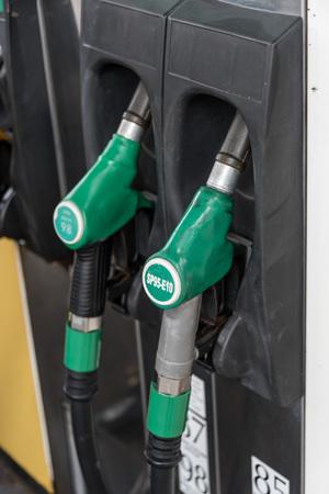 green fuel: Green fuel pump nozzle