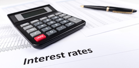 interest rates: Interest rates documents with calculator Stock Photo