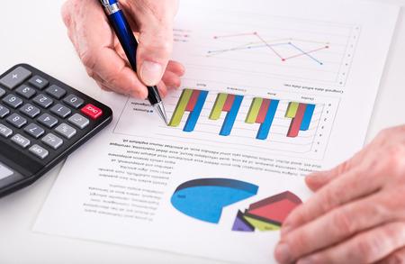 analyzed: Graphic analyzed by a businessman (random latin dummy text used) Stock Photo
