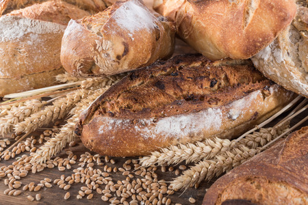 Composition of various breads, on wooden background Stok Fotoğraf