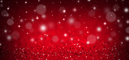 Christmas background with red glitters, sparkles and bokeh