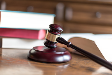 juridical: Judge gavel with law books Stock Photo
