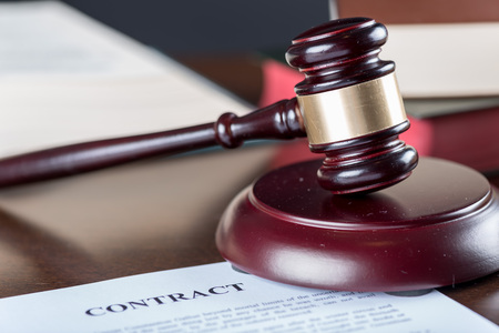 gavel: Judge gavel with contract