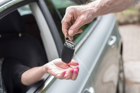auto leasing: Man handing another person automobile keys Stock Photo