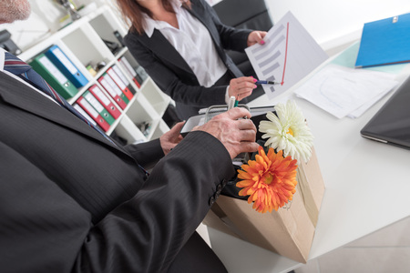 layoff: Employee laid off by a businesswoman