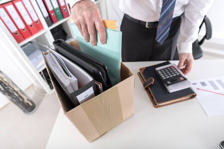 unemployed dismissed: Businessman fired, putting his personal effects in a box