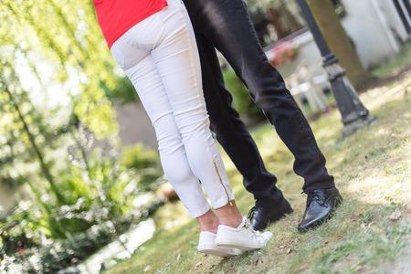 hugging legs: Legs of a couple hugging in park