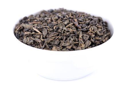 gunpowder: Green gunpowder tea, isolated on white Stock Photo