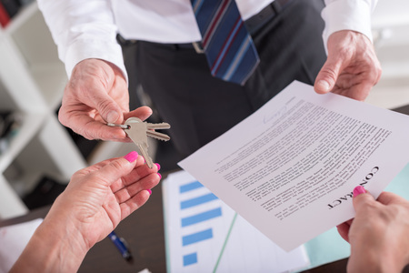 agency agreement: giving house keys to his client after signing the contract (random english dummy text used)