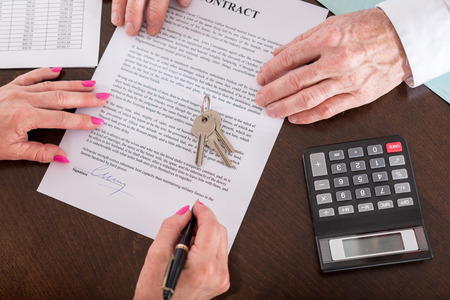 signed: Real estate contract signed (random english dummy text used) Stock Photo