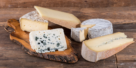 varieties: Composition with different varieties of French cheeses Stock Photo