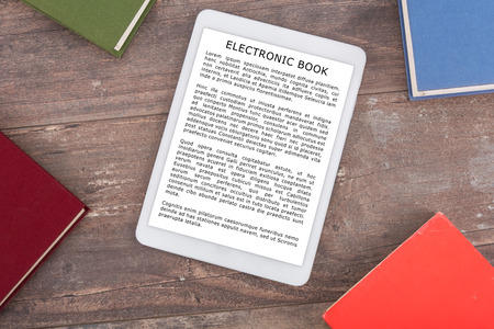 e book device: Ebook and books, top view (lorem ipsum text used)