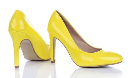 Yellow high heels shoes, isolated on white Stock Photo
