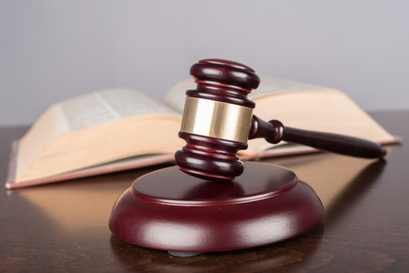law symbol: Judge gavel with law book Stock Photo