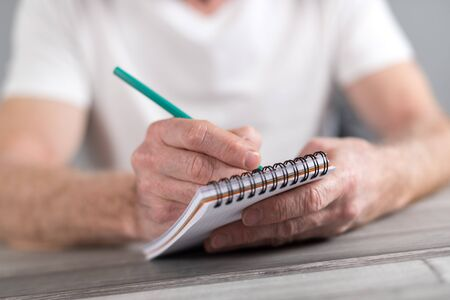 pocket book: Man taking notes on a pocket book