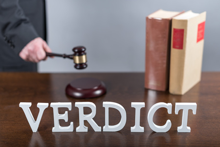 Verdict concept with a lawyer in background Stock Photo