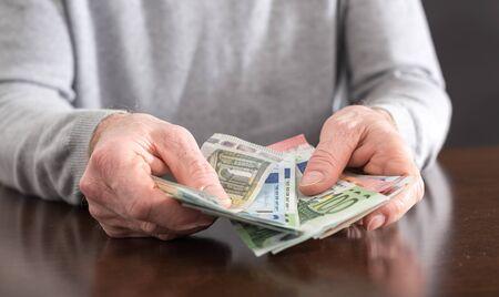 euro banknotes: Hands counting euro banknotes