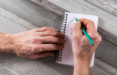 pocket book: Hand about to take notes on a pocket book