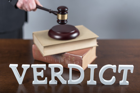 verdict: Verdict concept with a lawyer in background Stock Photo