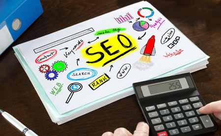 keywords link: Seo concept illustrated on a paper with a calculator