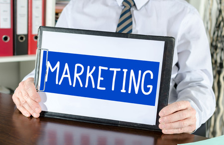 shown: Marketing concept shown by a businessman Stock Photo