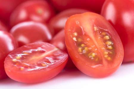 half  cut: Half cut cherry tomato, close up Stock Photo