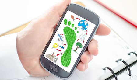 Carbon footprint concept shown on a smartphone screen Stock Photo