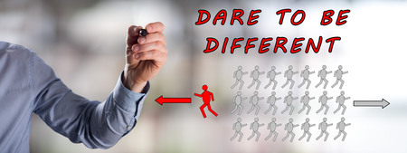 Man drawing a dare to be different concept Stock Photo