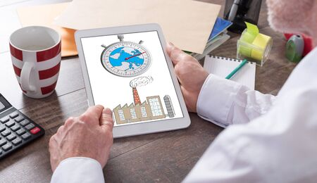 change concept: Climate change concept shown on a tablet held by a man Stock Photo