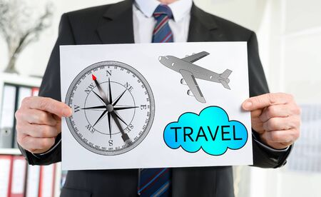 held: Paper showing travel concept held by a businessman