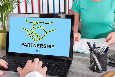alliances: Laptop screen with partnership concept