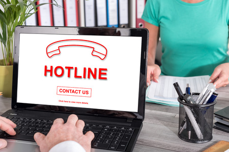 hotline: Laptop screen with hotline concept Stock Photo