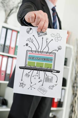 data processing: Paper showing data processing concept held by a businessman