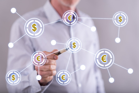 financial symbols: Man touching a financial network on a touch screen with a pen