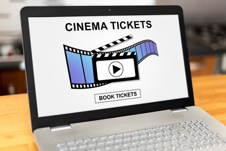 reservations: Laptop screen with online cinema tickets booking concept