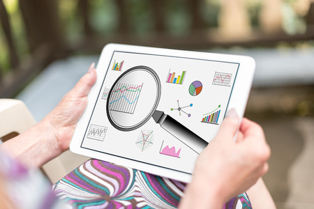 Data analysis concept shown on a tablet held by a woman Stock Photo