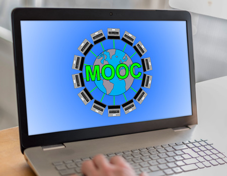 university application: Laptop screen with mooc concept Stock Photo