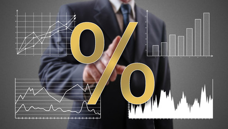 point of interest: Interest rates concept shown by a businessman in background Stock Photo