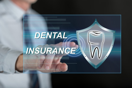 Man touching a dental insurance concept on a touch screen with his finger