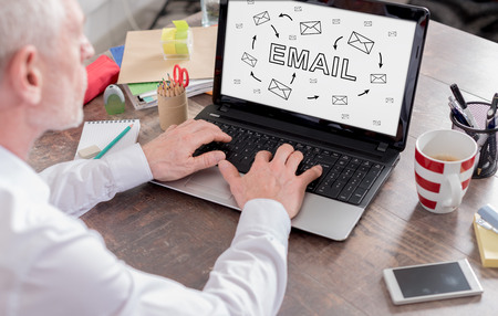 envelope: Email concept shown on a laptop screen