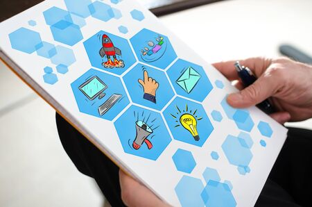Digital marketing concept on a paper held by a hand