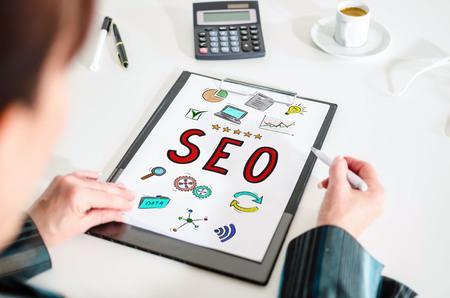 keywords link: Woman looking at a seo concept