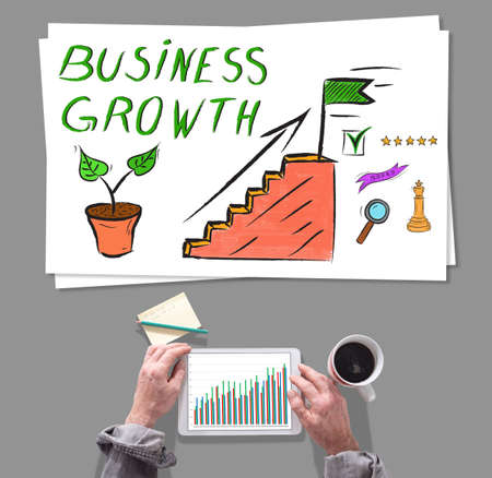 using tablet: Male hands using tablet in front of business growth concept