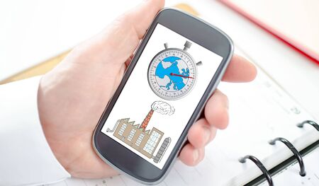 Climate change concept shown on a smartphone screen Stock Photo