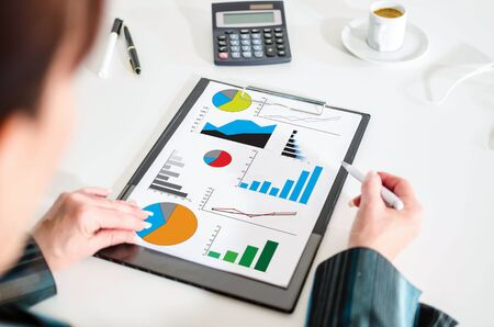 graphical chart: Woman looking at a graphical analysis concept Stock Photo