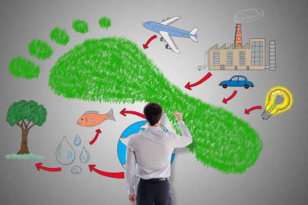 사업가에 의해 그려진 탄소 발자국 개념