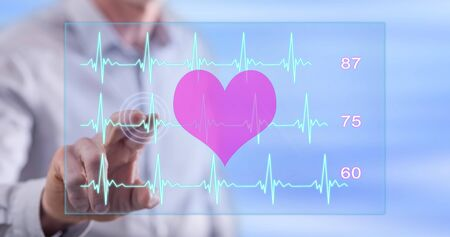 Man touching a heart beats graph concept on a touch screen with his finger Banco de Imagens - 82885403