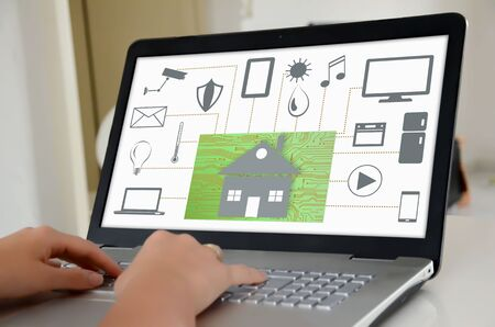 security monitor: Hands on a laptop with screen showing home automation concept Stock Photo