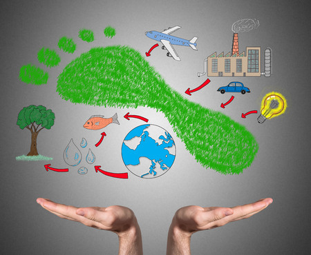 手を支える炭素フット プリントの概念