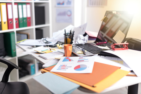 Messy And Cluttered Office Desk, Light Effect Stock Photo   83234064